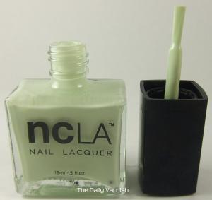 NCLA brush bottle